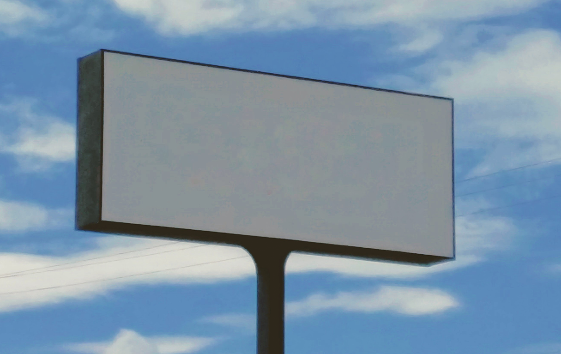 blank billboard in front of clouds